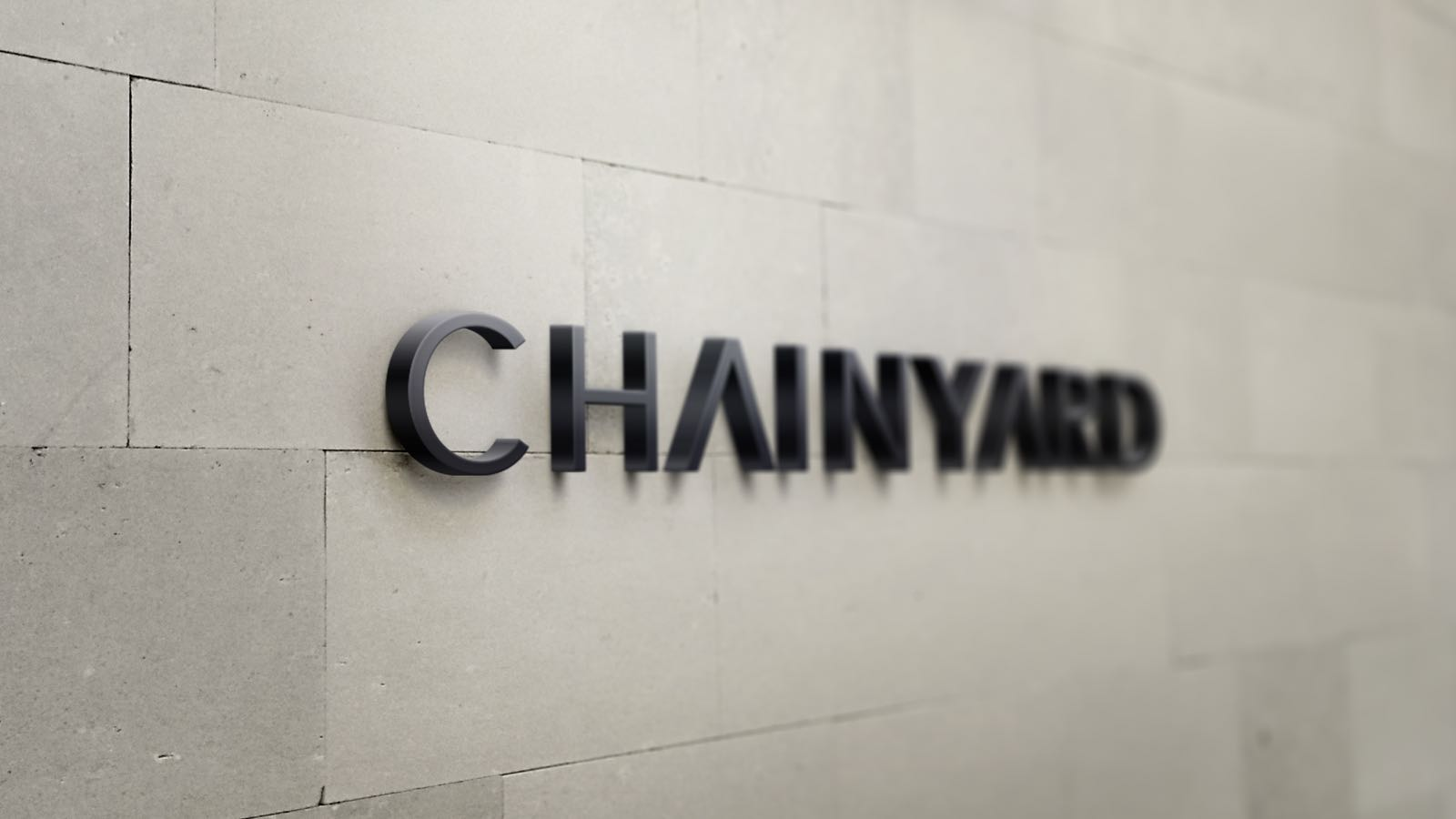 The Chainyard logo mounted on a brick wall